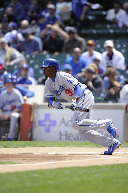 CHICAGO - MAY  04:  Dee Gordon #9 of the Los Angeles Dodgers bunts against the Chicago Cubs on May 4, 2012 at Wrigley Field in Chicago, Illinois.  The Cubs defeated the Dodgers 5-4.  (Photo by Ron Vesely)   Subject:  Dee Gordon