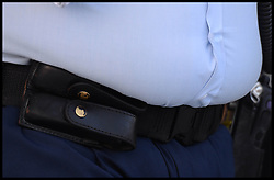 An Australian Police officer with his stomach over his belt in Brisbane, Australia. Saturday, 19th April 2014. Picture by Andrew Parsons / i-Images