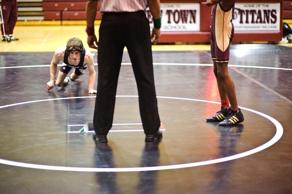 (staff photo by Matt Roth)..Cliff McCormick, Towson's 103-pound.wrestler .cerebral palsy .cannot use his legs..Asst. Coach Martin Brakke.head coach Phil Simmonds .New Town High School .Thursday, January 21, 2010.