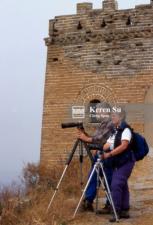 Western couple with camera on the Great Wall, China