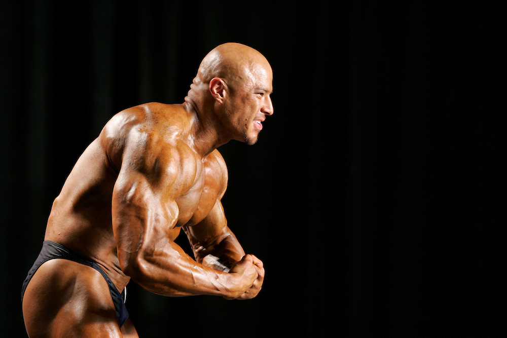 Scott Morgan\The Hawk Eye.Mr. Iowa winner Chris Genkinger of Burlington flexes as he shows off for the judges during the individual pose time Saturday, June 16, 2007 during the National Physique Committee Junior National Bodybuilding, Fitness and Figure Championships in Rosemont, Ill.