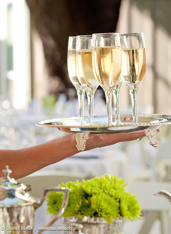 Champagne glasses held on silver serving tray