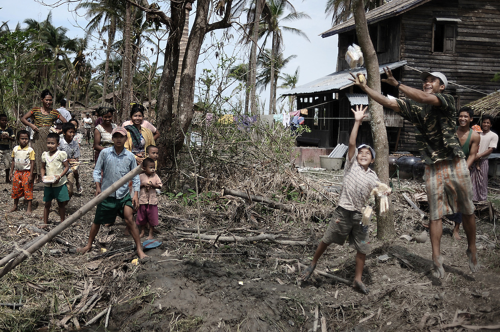 Children from the village of Chaung Lin jump to receive food thrown from a boat by locals on May 23, 2008 in the isolated area of Kanzeik in the Irrawaddy Delta region -- an area only accessible by boat which has received neither government nor foreign aid. Voters in regions devastated by the cyclone, many hungry and destitute, cast ballots on May 24 in a referendum that many said was meaningless because Myanmar's junta has already declared victory.