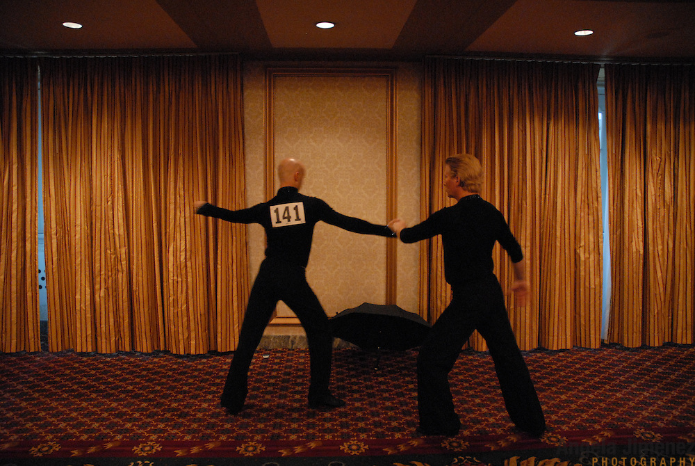 ****EMBARGO: NOT FOR PUBLICATION IN THE ADVOCATE, CURVE, GONYC OR OUT MAGAZINES..Gay ballroom dancers warm up before they compete during the Dancesport ballroom dancing competition at the Hilton Hotel and Towers in downtown Chicago during Gay Games VII on July 20, 2006. ..Over 12,000 gay and lesbian athletes from 60 countries are in Chicago competing in 30 sports during the Games from July 15 through 22, 2006. ..Over 50,000 athletes have competed in the quadrennial Games since they were founded by Dr. Tom Wadell, a 1968 Olympic decathlete, and a group of friends in San Francisco in 1982, with the goal of using athletics to promote community building and social change. ..The Gay Games resemble the Olympics in structure, but the spirit is one of inclusion, rather than exclusivity. There are no qualifying events or minimum or maximum requirements...The Games have been held in Vancouver (1990), New York (1994), Amsterdam (1998), and Sydney (2002). .
