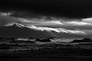 Huge seas (for Aberffraw, rolled right up to the top of this long flat beach, whilst breakers of cloud rolled over the stormy peaks of the Welsh mountains of the Llyn Peninsula in the background.<br /> <br /> Available in A4 and A3 sizes only