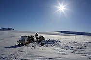 Glaciologist Jack Kohler works with colleague to take ice cores from snow pit atop Kongsvegen glacier 750 meters (2460 feet) above sea level at Kongsfjorden; Svalbard, Norway.