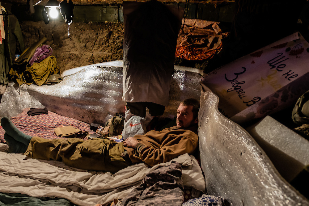 Soldier having a rest inside one of the front line position campement.