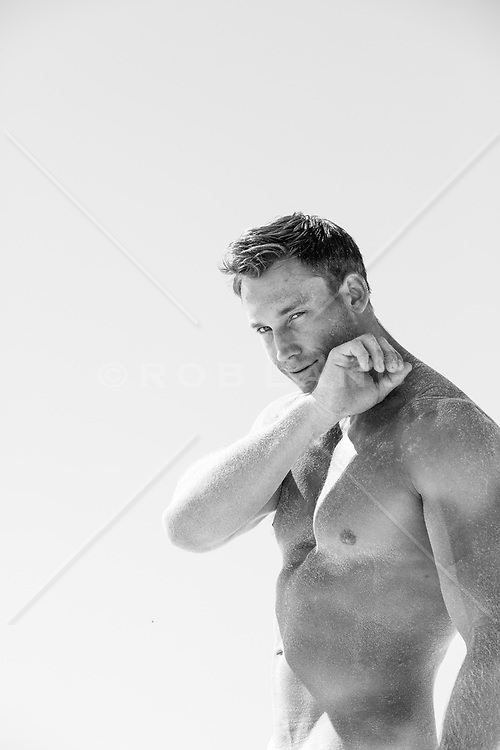 portrait of a handsome shirtless man outdoors
