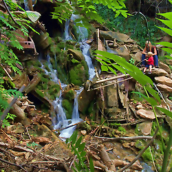 Car Canyon Falls. Hidden within Jerome overflow spring water flows through a canyon of classic cars as old as a century.