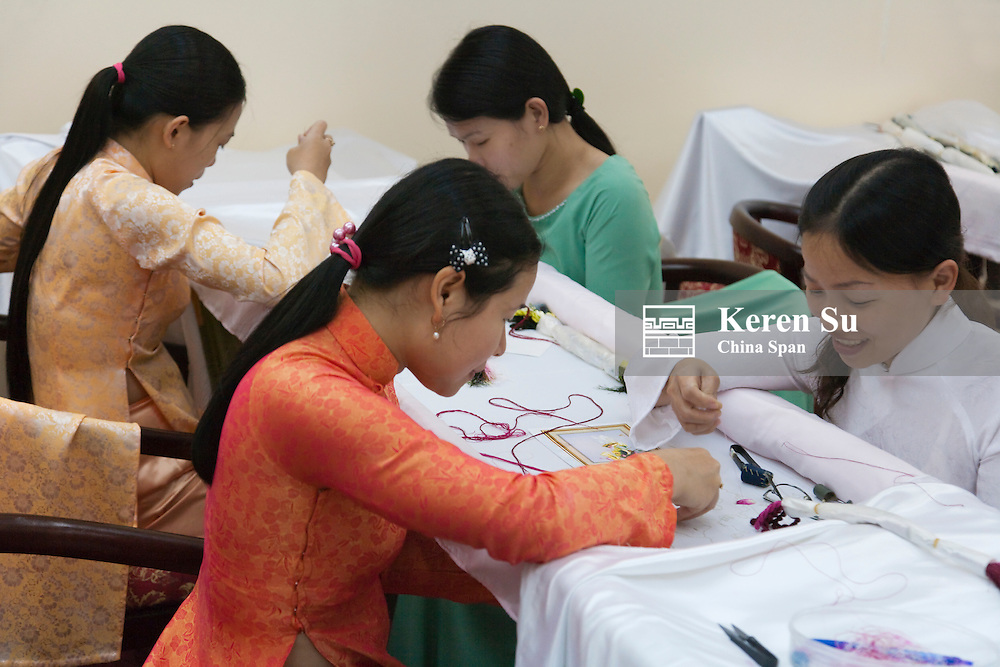 Girls doing embroidery.