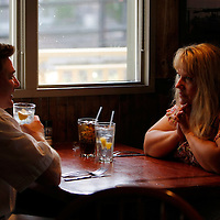 """Carolyn Dawson, bariatric surgery patient talks with her husband Kelly at a restaurant  in Westminster, Colorado three days before her operation August 27, 2010. Dawson called it her """"last supper"""" as after the dinner she wouldn't be allowed to each more than a few ounces of food for the rest of her life. REUTERS/Rick Wilking (UNITED STATES)"""