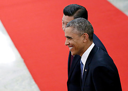 epa04485883 US President Barack Obama (front) and Chinese President Xi Jinping review honor guards during a welcome ceremony at the Great Hall of the People (GHOP) in Beijing, China, 12 November 2014. Obama is in China to attend the Asia-Pacific Economic Cooperation (APEC) 2014 Summit and related meetings.  EPA/HOW HWEE YOUNG
