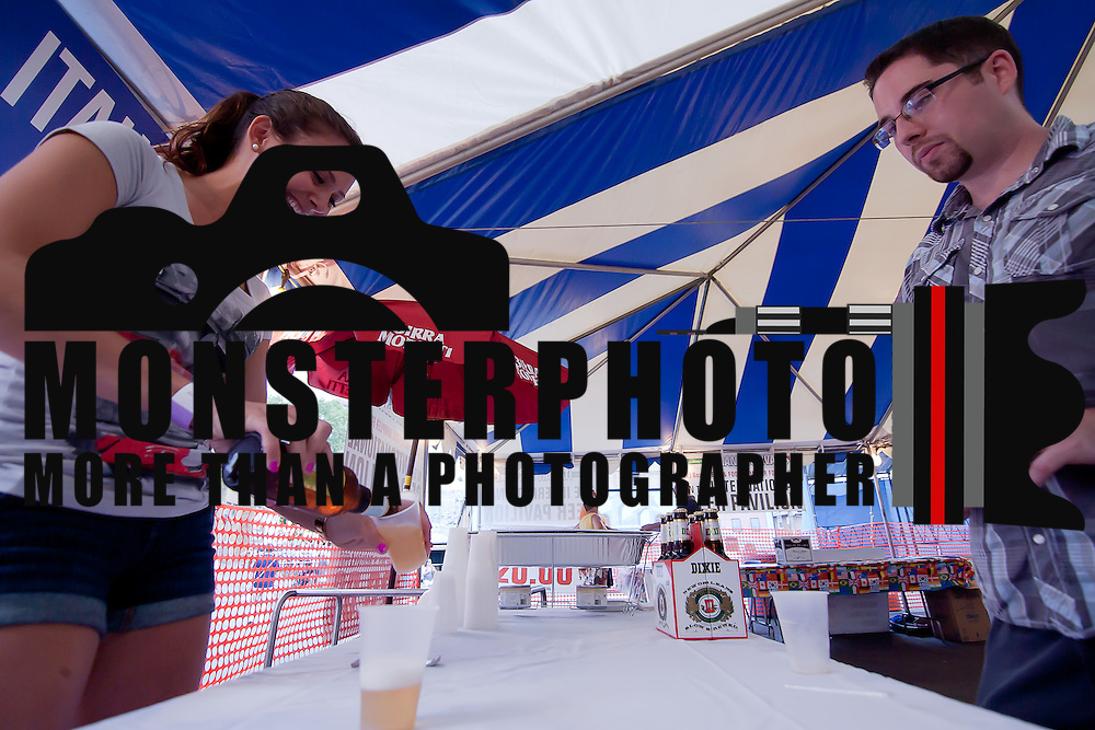 06/11/12 Wilmington Del: Cicerone-certified beer server Christine Whitfield servers a sample of Birra Moretti to Dave Coverdale (Right) during the inaugural International Beer Tasting Event Monday, June 11, 2012, at St. Anthony's Italian Festival in Wilmington Delaware...Special to The News Journal/SAQUAN STIMPSON