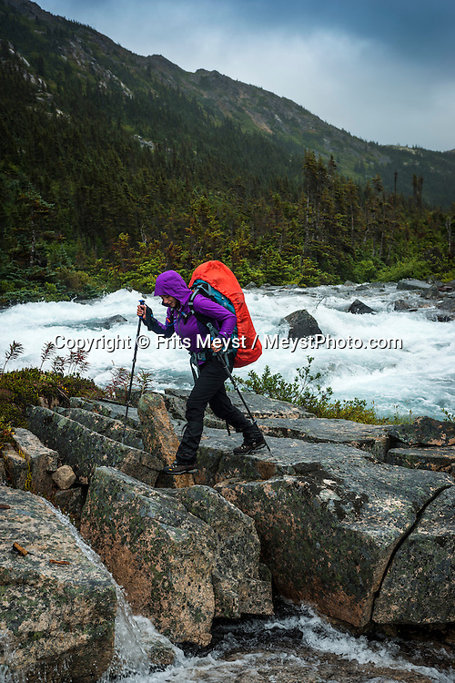 Alaska, USA to Yukon Territory, Canada, September 2014. Hiking between Long lake and Deep lake on our way to Lindeman City. Campground. Starting at Dyea, Alaska, The Chilkoot Trail retraces the Klondike Gold Rush route that most stampeders followed to get to the gold fields. Steeped in Klondike Gold Rush history and scattered with relics from the past, the famous Chilkoot Trail is also referred to as the longest open air museum in the world. This rugged 55 kilometer wilderness trek is a world-renowned hiking trail and Canada's largest National Historic Site. Photo by Frits Meyst / MeystPhoto.com