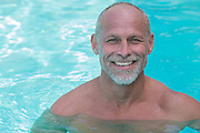sexy middle aged man in a swimming pool