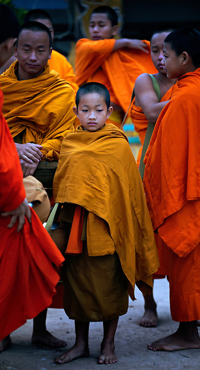 Novices and monks collecting alms in Luang Namtha, Laos.