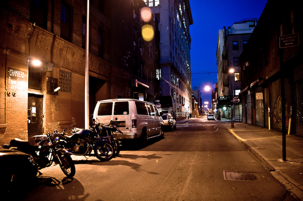 Bikes parked on Plymouth street by night in DUMBO, Brooklyn, New yORK, 2009.