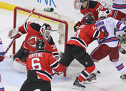 May 19, 2012; Newark, NJ, USA; New Jersey Devils center Adam Henrique (14) and New York Rangers right wing Marian Gaborik (10) battle for the rebound after a save by New Jersey Devils goalie Martin Brodeur (30) during the first period in game three of the 2012 Eastern Conference Finals at the Prudential Center.
