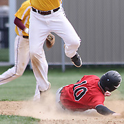 William Penn Outfielder Corey Johns (10) slides into second base safely during of a varsity scheduled game between the Colonials of William Penn and The St. Elizabeth Vikings Saturday, April 25, 2015, at William Penn High School baseball field in New Castle Delaware.<br /> <br /> William Penn defeats St. Elizabeth 6-5