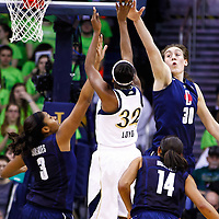 SOUTH BEND, IN - MARCH 04: Morgan Tuck #3 of the Connecticut Huskies and Breanna Stewart #30 of the Connecticut Huskies defend as Jewell Loyd #32 of the Notre Dame Fighting Irish shoots a jumper at Purcel Pavilion on March 4, 2013 in South Bend, Indiana. (Photo by Michael Hickey/Getty Images) *** Local Caption *** Morgan Tuck; Breanna Stewart; Jewell Loyd