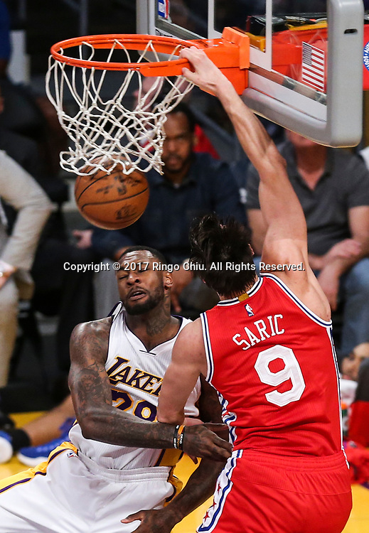 Philadelphia 76ers forward Dario Saric (#9) dunks against Los Angeles Lakers center Tarik Black (#28) during an NBA basketball game Tuesday, March 12, 2017, in Los Angeles. <br /> (Photo by Ringo Chiu/PHOTOFORMULA.com)<br /> <br /> Usage Notes: This content is intended for editorial use only. For other uses, additional clearances may be required.