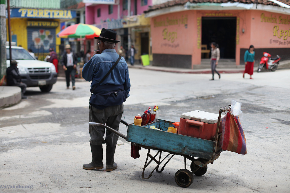 A shaved-ice street vendor awaits customers. Nebaj, Quiche, Guatemala. June 06, 2013.