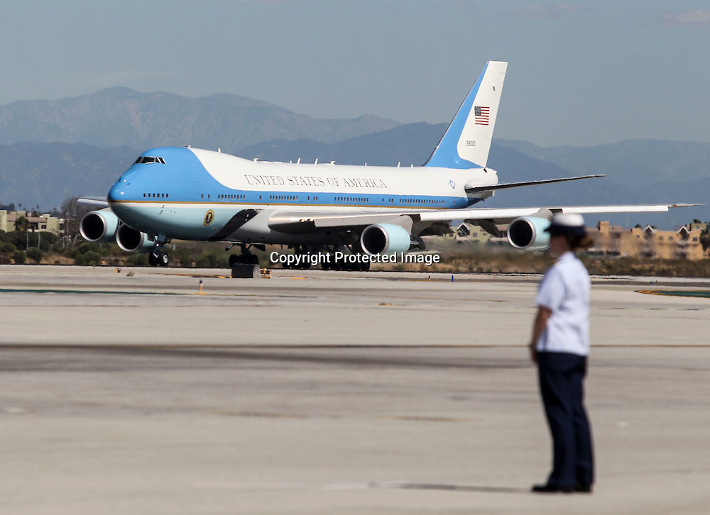 A security personnel stands as Air Force One, with President Barack Obama aboard, taxis at Los Angeles International Airport in Los Angeles on Saturday, Oct. 10, 2015. (AP Photo/Ringo H.W. Chiu)