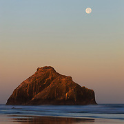 Face Rock, located on the Oregon coast at Bandon, appears to gaze at the full moon. According to Native American legend, the face belongs to the beautiful Indian princess Ewanua. While several tribes gathered nearby to celebrate, she wandered to the sea inhabited by Seatka, the evil spirit of the ocean. He turned her to stone whlie she stared at the moon.