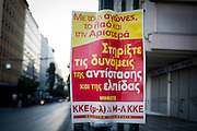 A sign posted by the communist party of Greece (KKE) to support their cause in their electoral campaign in Athens, Greece. Image © Angelos Giotopoulos/Falcon Photo Agency
