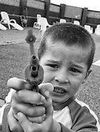 Young Boy With Gun, East Coast, England - 1997