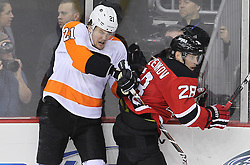 May 6, 2012; Newark, NJ, USA; Philadelphia Flyers left wing James van Riemsdyk (21) gets hit by New Jersey Devils defenseman Anton Volchenkov (28) during the second period in game four of the 2012 Eastern Conference semifinals at the Prudential Center.