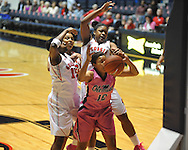 "Ole Miss' Diara Moore (10) vs. Georgia's Shacobia Barbee (20), Jasmine Hassell (12), and Krista Donald (12) in women's basketball at the C.M. ""Tad"" Smith Coliseum in Oxford, Miss. on Sunday, February 24, 2013. Georgia won 73-54."