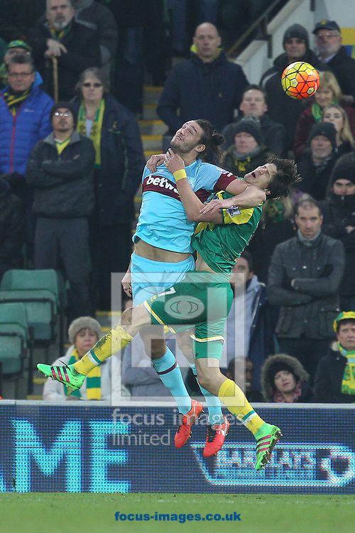 Andy Carroll of West Ham and Timm Klose of Norwich in action during the Barclays Premier League match at Carrow Road, Norwich<br /> Picture by Paul Chesterton/Focus Images Ltd +44 7904 640267<br /> 13/02/2016