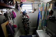 Maria Rosario has lived with mold for 10 years in the bathroom, kitchen and bedroom. She has been diagnosed with asthma. Melrose Houses, Bronx, NY, 2012.