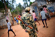 Members of the Central Regional Police force keep watch during Good Friday services at a camp for displaced Christians April 10, 2009 in the town of Mondesore in the state of Orissa, India. Tensions remain high in the area several months after violence by Hindu fundamentalist towards the Christian minority  forced thousands from their homes and leaving several churches and homes destroyed.