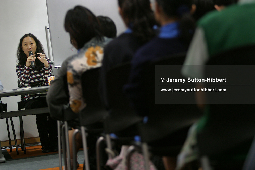 Chen Danyan, a Chinese novelist/writer speaks to an audience in the British Council offices in Hong Kong, as part of the Think UK Writers Train project. The Think UK China Writers Train is a project, in collaboration with the British Council, to take 4 UK writers/poets and 4 Chinese writers/poets around China by train visiting 6 major cities, in 17 days, to hold talks, seminars and readings of their work.