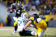 PITTSBURGH, PA - JANUARY 23: Rashard Mendenhall #34 of the Pittsburgh Steelers rushes against the New York Jets in the AFC Championship Playoff Game at Heinz Field on January 23, 2011 in Pittsburgh, Pennsylvania(Photo by: Rob Tringali) *** Local Caption *** Rashard Mendenhall