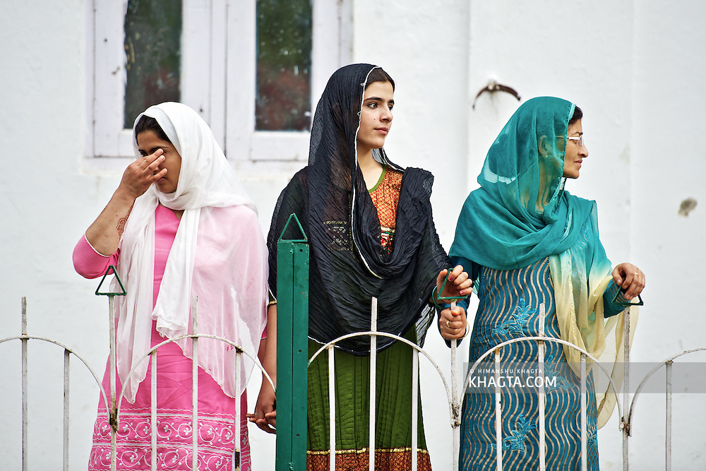 A girl wipes her tears after Moi-e-Muqaddas is displayed publically. Muslims who witness the holy relic become emotional when they see it...Devotees converged for peace prayers at the famous Muslim shrine of Hazratbal to mark Meraj-ul-Alam festival in Srinagar, Prophet Mohammed's Moi-e-Muqaddas (Holy Relic) is displayed for public viewing on ten occasions in a year, which includes Meraj-ul Alam.