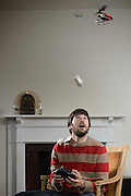 A remote controlled helicopter air drops cash to Josh Lewis.<br />
