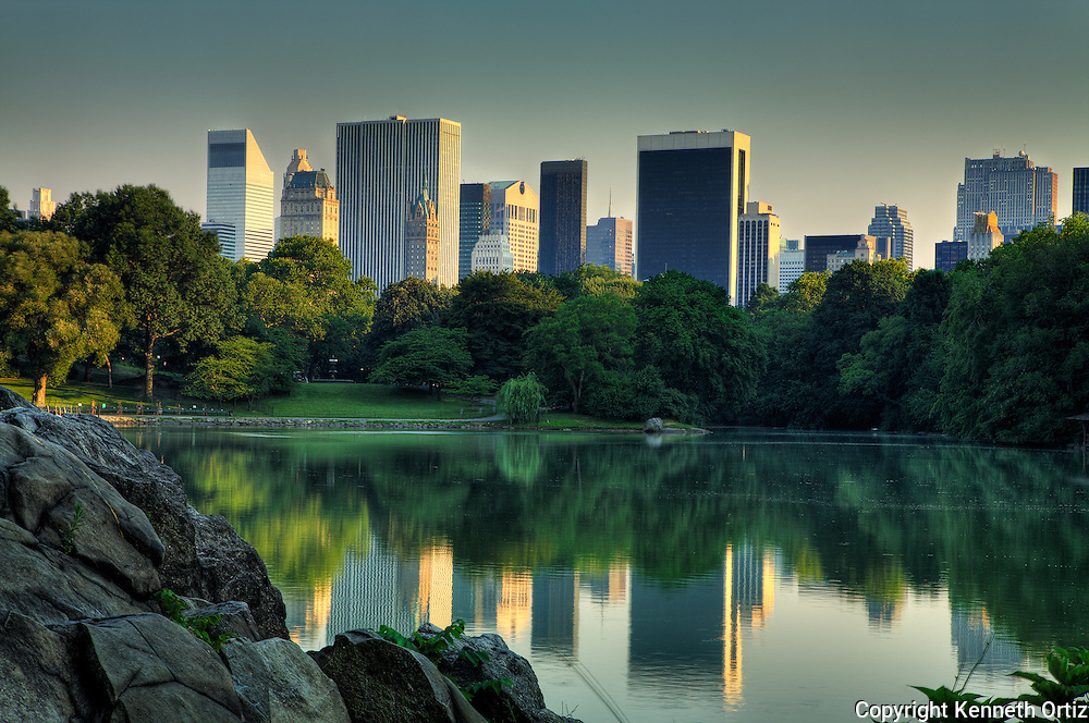 A view of Central Park Lake at around dusk, looking toward Central Park South.