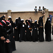 Women protestors take part in a rally near Sanaa's Change Square. President Ali Abdullah Saleh travelled to Saudi Arabia to sign the GCC-brokered transfer of power agreement on 23 November 2011. Many protestors are unhappy with the GCC deal, particularly the immunity from prosecution granted to President Saleh. Photo: Lindsay Mackenzie / Falcon Photo Agency.