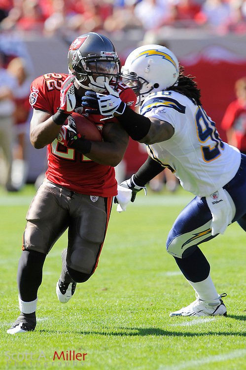 Dec. 21, 2008; Tampa, FL, USA; Tampa Bay Buccaneers running back Clifton Smith (22) is tackled by San Diego Chargers defensive end Keith Grennan (96) during the Bucs 41-24 loss at Raymond James Stadium. ©2008 Scott A. Miller
