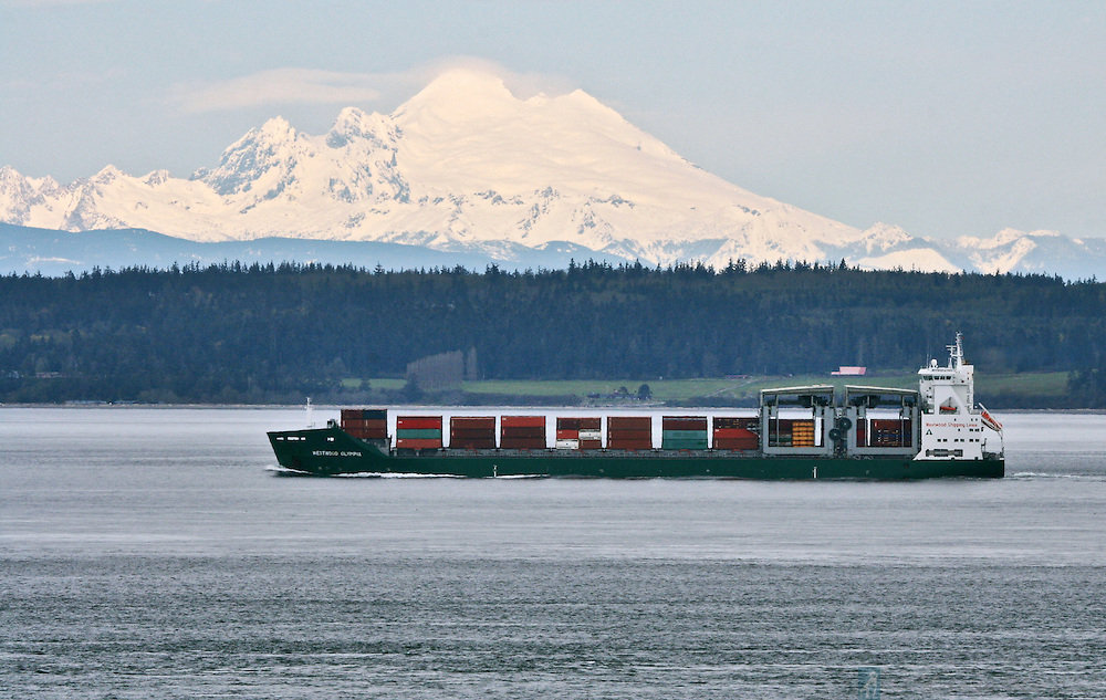 Weyerhauser's Westwood Olympia leaving Washington's Puget Sound through the Admiralty Inlet with Whidbey Island and Mount Baker in the background