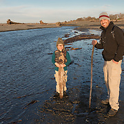 A father and son from Arizona explore the Elwha River delta mouth.