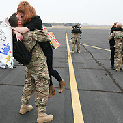 Gary Cosby Jr./Decatur Daily   Anthony Taylor kisses his wife Rebekah during the homecoming for the U.S. Army Reserve 663rd Horizontal Engineering Company based in Sheffield Wednesday at Signature Aviation in Huntsville.  The unit had been deployed to Afghanistan.  The couple lives in Fultondale.