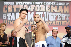 June 4, 2010; Bronx, NY; USA;  Miguel Cotto (r) and Yuri Foreman (l) pose at the weigh-in for their upcoming fight.  The two fighters will meet tomorrow night at Yankee Stadium in Bronx, NY.