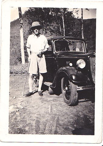 &quot;Man with Austin 7 car, unknown person or location&quot;.<br />