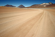 Road on the Bolivian Altiplano near the border between Chile & Bolivia. In the distance is Volcan Licancabur