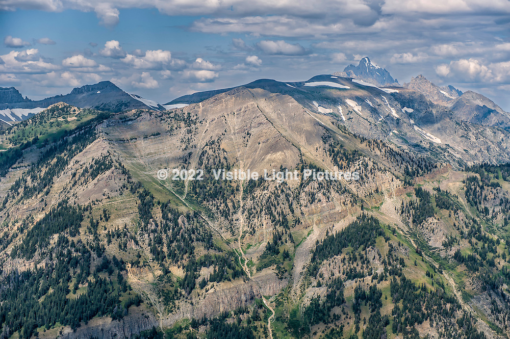 The Grand Tetons as seen from the summit of Rendezvous Mountain in Jackson Hole, Wyoming