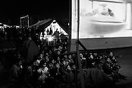 16 April 2016, Idomeni Greece - Refugee children watching a cartoon movie.